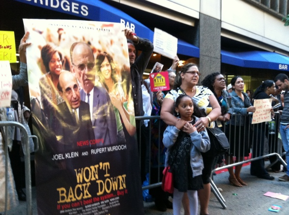 A photo from the protest against the premiere of the movie Won't Back Down. Full explanatory caption below.